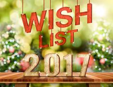 Wish list 2017 number on Brown Wood table top with abstract blur christmas tr Stock Illustration