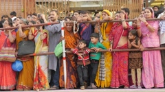 Indian spectators watch procession,Jaipur,Gangaur,India Stock Footage