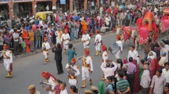 Procession with brass band and bullock carts,Jaipur,Gangaur,India Stock Footage