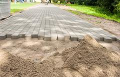 Construction of a new pavement of paving slabs Stock Photos