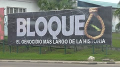 A billboard in havana proclaims the bad effects of the U.S. economic blockade on Stock Footage