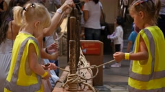 Kids play with educational stand in cognitive museum for children Stock Footage