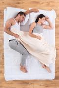 Nice couple sleeping on bed Stock Photos