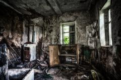 Old forgotten and abandoned home interior in a derelict decaying state with g Stock Photos