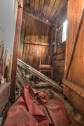 Old forgotten and abandoned home interior in a derelict decaying state with d Stock Photos