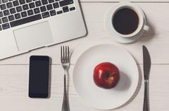 Diet concept, only apple at business lunch in the office Stock Photos