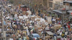 Busy market with manual labour transport of jute bags,New Delhi,India Stock Footage