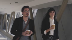 Business man and woman meeting in hallway Stock Footage