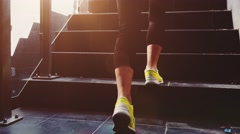 Woman Feet Jogging up Stairs, Lens Flare. SLOW MOTION 120 fps STABILIZED shot. Stock Footage