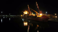 Unloading Cargo from a Ship in the Sea Port of Batumi by Night. Time Lapse Stock Footage