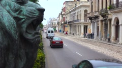 Traffic passes on the streets of the old city of Havana, Cuba with classic old Stock Footage