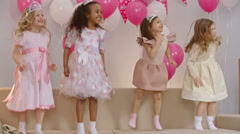 Little Girls Jumping and Waving on Sofa Stock Footage