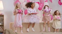 Kids Jumping With Birthday Presents Stock Footage