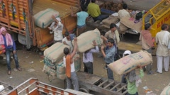 Manual labour with unloading jute spice bags from truck,New Delhi,India Stock Footage