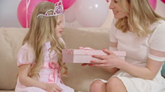 Loving Mom Giving Birthday Present to Daughter Stock Footage