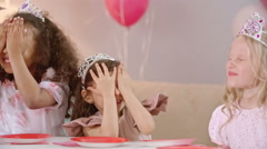 Little Cuties Blowing Candles on Birthday Cake Stock Footage