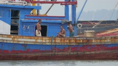 Fishermen relaxing and smoking on boat,Penang,Malaysia Stock Footage