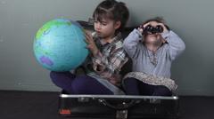 Traveler children in a travel suitcase Stock Footage
