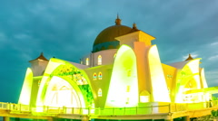 Illuminated floating mosque at night Stock Footage