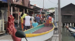 Tourists on Chew Clan jetty,Penang,Malaysia Stock Footage