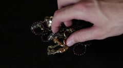 Man touching jewelry on black background Stock Footage