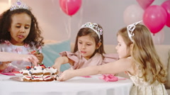 Kids Eating Best Part of Birthday Cake Stock Footage