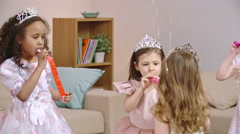 Kids Celebrating Birthday with Party Horns Stock Footage
