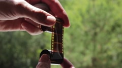 Holding negative photographic tape Stock Footage