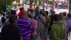 Large crowds gather in Havana Cuba central park to debate and talk about issues Stock Footage