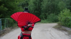 Woman with a Fan dancing samurai Stock Footage