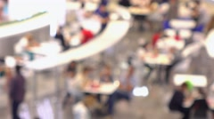 Unrecognizable people eating fast food in shopping center food court. 4K Stock Footage