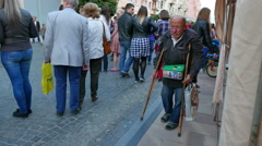 4K. Street  beggar on crutches Stock Footage
