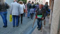 4K. Street  beggar on crutches Stock Footage
