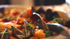 Seafood rice just done in a restaurant, slider shot Stock Footage
