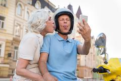 Mature couple showing tongues. Stock Photos
