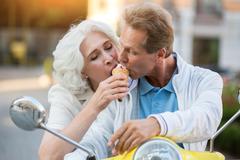 Mature couple shares ice cream. Stock Photos