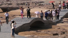 Tourists visit Hukou waterfall at the Yellow river (Huang He) in Yichuan, China. Stock Footage