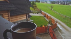 Coffee or Tea. Brown Rustic Cup of hot beverage with Steam Outdoors. 4K. Stock Footage