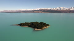 Aerial view of Lake Pukaki and Morgans Island, New Zealand Stock Footage