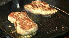 Cook cooking steak on frying pan Stock Footage