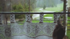 Hand Opening Window Curtain to see the Pouring Rain. 4K. Stock Footage
