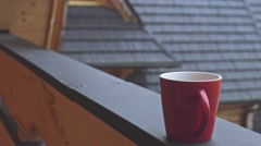 Red Cup of coffee or tea Steaming in Rainy Outdoors. SLOW MOTION 120 fps. Stock Footage