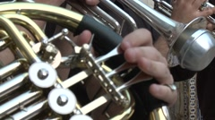 Orchestra musician playing tube french horn instrument Stock Footage