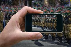 Military detachment, the soldiers standing in formation. phone in hand man Stock Photos