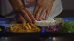 Chef prepares sushi roll Stock Footage