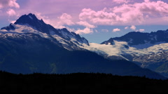 4K Faraway Snow Capped Peaks, Mountain Range Silhouette at Dusk Stock Footage