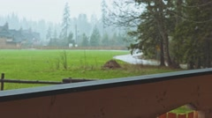 Sad Man is standing on the Terrace, Rain on Background. SLOW MOTION 120 fps. Stock Footage
