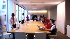 Timelapse of business team working together in boardroom of modern office Arkistovideo