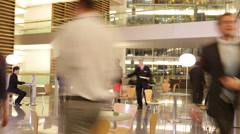 Time lapse of diverse group of business people in the lobby of a modern Stock Footage