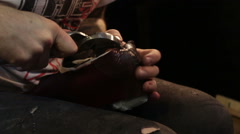 Shoemaker sews shoes.  Hammering leather. Stock Footage